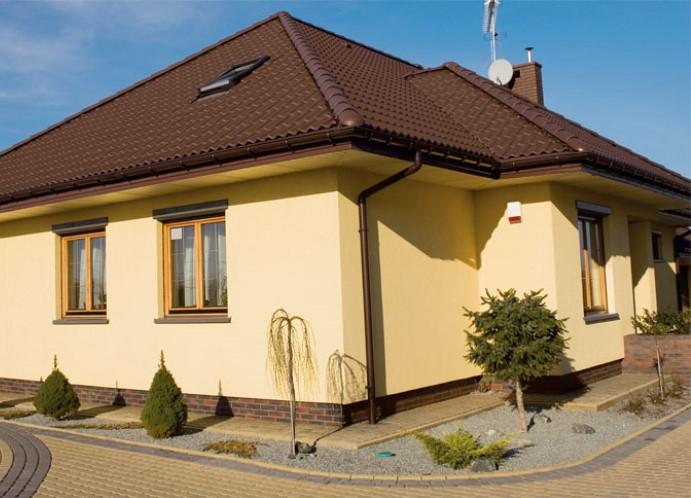 Дизайн фасада частного дома штукатуркой