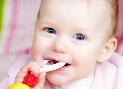 Первый зубик у ребенка