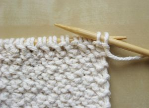 Узор плетенка спицами 11