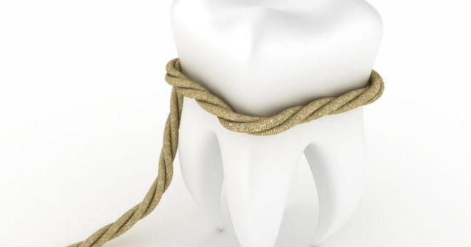 Удалять зуб больно