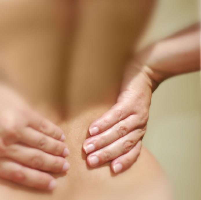 Причины болей в пояснице во время менструации