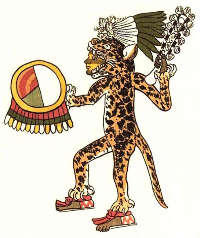 Человек в костюме ягуара с бубном