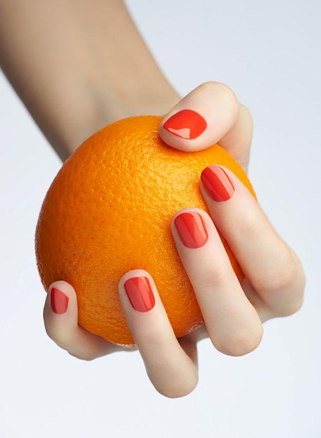 Cuatro manicura naranja brillante