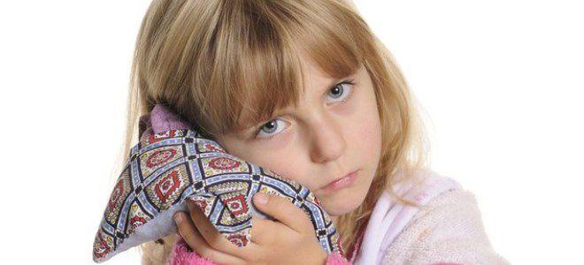 Почему болит молочный зуб у ребенка